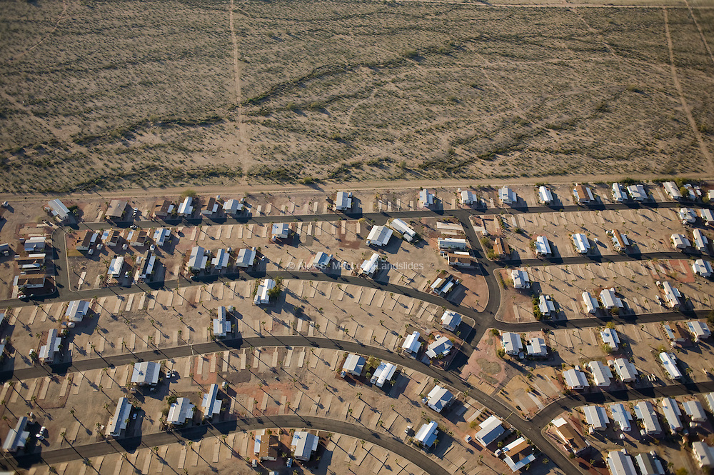 Buckeye's population has tripled in the last six years from roughly 10,000 to roughly 30,000 residents, making it the second-fastest growing city in America.  The Bona-Vista mobile-home park, seen here, has yet to be fully filled with manufactured homes.