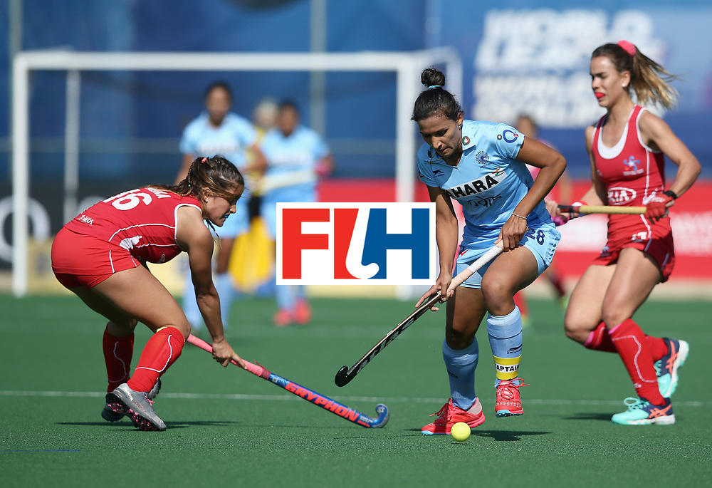 JOHANNESBURG, SOUTH AFRICA - JULY 12: Rani of India and Constanza Palma of Chile battle for possession during day 3 of the FIH Hockey World League Semi Finals Pool B match between India and Chile at Wits University on July 12, 2017 in Johannesburg, South Africa. (Photo by Jan Kruger/Getty Images for FIH)