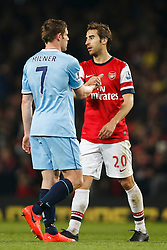 Man City Midfielder James Milner (ENG) shakes hands with Arsenal Goalscorer Mathieu Flamini (FRA) after the game finishes in a 1-1 draw - Photo mandatory by-line: Rogan Thomson/JMP - 07966 386802 - 29/03/14 - SPORT - FOOTBALL - Emirates Stadium, London - Arsenal v Manchester City - Barclays Premier League.