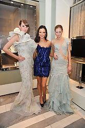 GEORGINA CHAPMAN flanked by models at a party to launch the Georgina Chapman collection for Garrard held at Garrard, Albermarle Street, London on 4th November 2009.