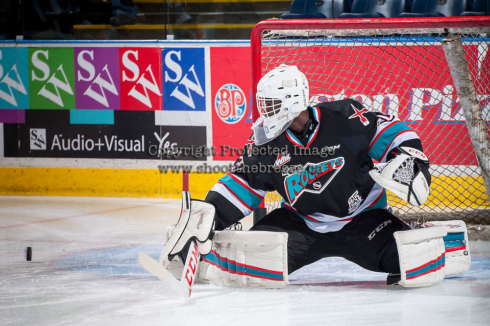 KELOWNA, CANADA - OCTOBER 23: Michael Herringer #30 of Kelowna Rockets  makes a a save against the Prince George Cougars on October 23, 2015 at Prospera Place in Kelowna, British Columbia, Canada.  (Photo by Marissa Baecker/Shoot the Breeze)  *** Local Caption *** Michael Herringer;