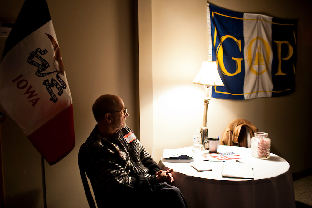 A man waits for supporters to arrive at a Cerro Gordo County GOP Fundraiser and campaign stop for  presidential candidate Rick Perry on Friday, December 30, 2011 in Mason City, IA.