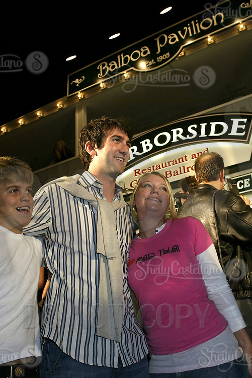 Oct 28, 2004; Newport Beach, CA, USA; Creator JOSH SCHWARTZ poses with fans for a photo on the FOX hit TV show 'The OC' visited the Balboa Penninsula in Newport Beach to get a Key to the City and be immortalized in cement with thier hand prints to be placed at the enterance to the Historic Balboa Pavillion.  Mandatory Credit: Photo by Shelly Castellano/ZUMA Press.