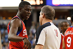 March 18, 2011; Sacramento, CA, USA;  Philadelphia 76ers point guard Jrue Holiday (left) talks to NBA referee Ron Garretson (10) during the first quarter against the Sacramento Kings at the Power Balance Pavilion. Philadelphia defeated Sacramento 102-80.