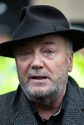 © Licensed to London News Pictures . 28/02/2015 . Newcastle , UK . Respect Party MP for Bradford West GEORGE GALLOWAY interviewed by media after speaking in support of Newcastle United , opposing the Pegida demonstration . Hundreds attend the first Pegida demonstration in the UK , at the Bigg Market in Newcastle . Photo credit : Joel Goodman/LNP