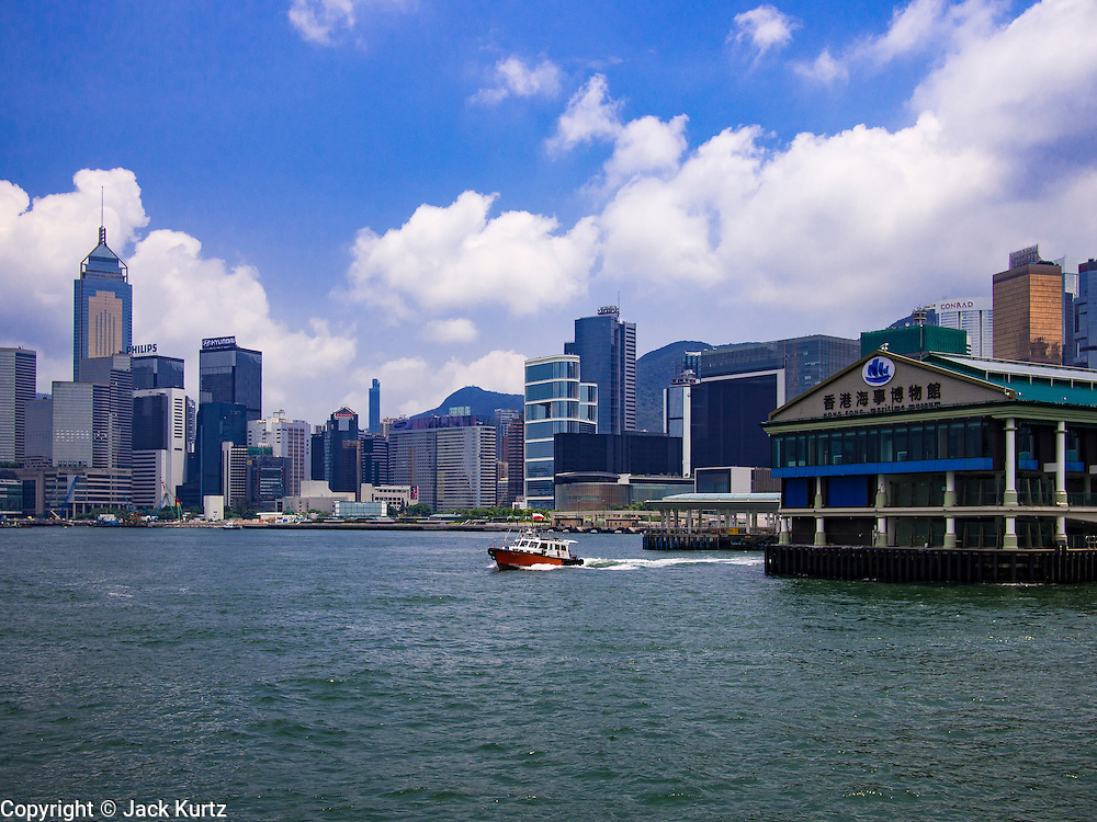 10 AUGUST 2013 - HONG KONG: The Star Ferry Terminal on Hong Kong Island with Causeway Bay neighborhood in background. Hong Kong is one of the two Special Administrative Regions of the People's Republic of China, Macau is the other. It is situated on China's south coast and, enclosed by the Pearl River Delta and South China Sea, it is known for its skyline and deep natural harbour. Hong Kong is one of the most densely populated areas in the world, the  population is 93.6% ethnic Chinese and 6.4% from other groups. The Han Chinese majority originate mainly from the cities of Guangzhou and Taishan in the neighbouring Guangdong province.      PHOTO BY JACK KURTZ