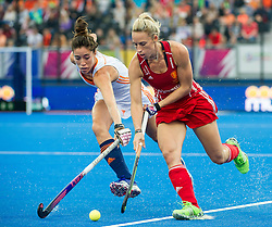 England's Susannah Townsend is tackled by Naomi Van As of the The Netherlands. England v The Netherlands - Final Unibet EuroHockey Championships, Lee Valley Hockey & Tennis Centre, London, UK on 30 August 2015. Photo: Simon Parker