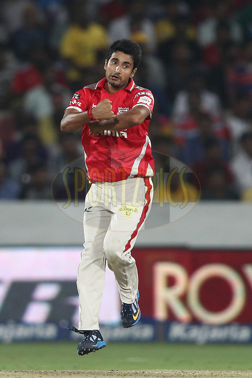 Karanveer Singh of the Kings XI Punjab sends down a delivery during the second semi final match of the Oppo Champions League Twenty20 between the Kings XI Punjab and the Chennai Superkings held at the Rajiv Gandhi Cricket Stadium, Hyderabad, India on the 2nd October 2014<br /> <br /> Photo by:  Shaun Roy / Sportzpics/ CLT20<br /> <br /> <br /> Image use is subject to the terms and conditions as laid out by the BCCI/ CLT20.  The terms and conditions can be downloaded here:<br /> <br /> http://sportzpics.photoshelter.com/gallery/CLT20-Image-Terms-and-Conditions-2014/G0000IfNJn535VPU/C0000QhhKadWcjYs