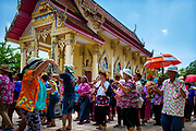 Members of the congregation dance in a procession around the ordination hall during #Songkran 2017 celebrations in rural Thailand April 14, 2017. PHOTO BY LEE CRAKER