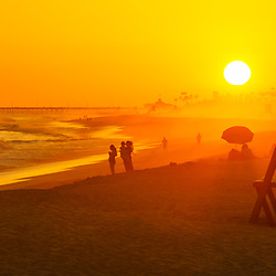 Newport Beach California Lifeguard Tower M sunset panorama photo. Balboa Peninsula is a popular area of Newport Beach along the Pacific Ocean in Orange County. Panoramic photo ratio is 1:3.  Copyright ⓒ 2017 Paul Velgos with All Rights Reserved.