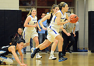 CB South's Haley Meinel #24 dribbles the ball up court as North Penn's Irisa Ye #11 falls down in the first quarter Friday December 11, 2015 at Central Bucks South in Warrington, Pennsylvania. (Photo by William Thomas Cain)