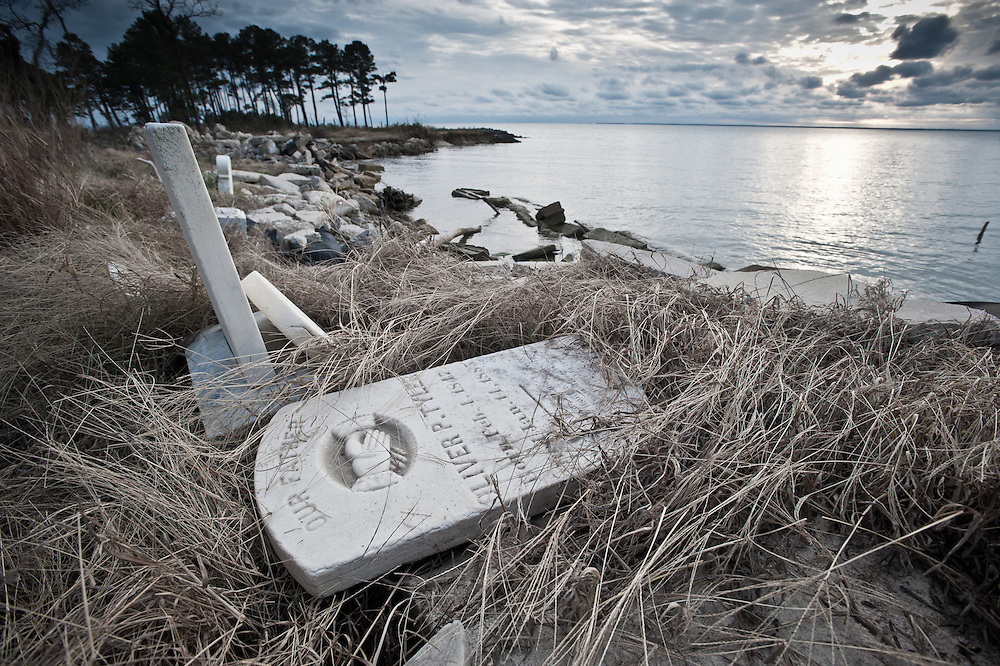 Headstones at a cemetery on the shore