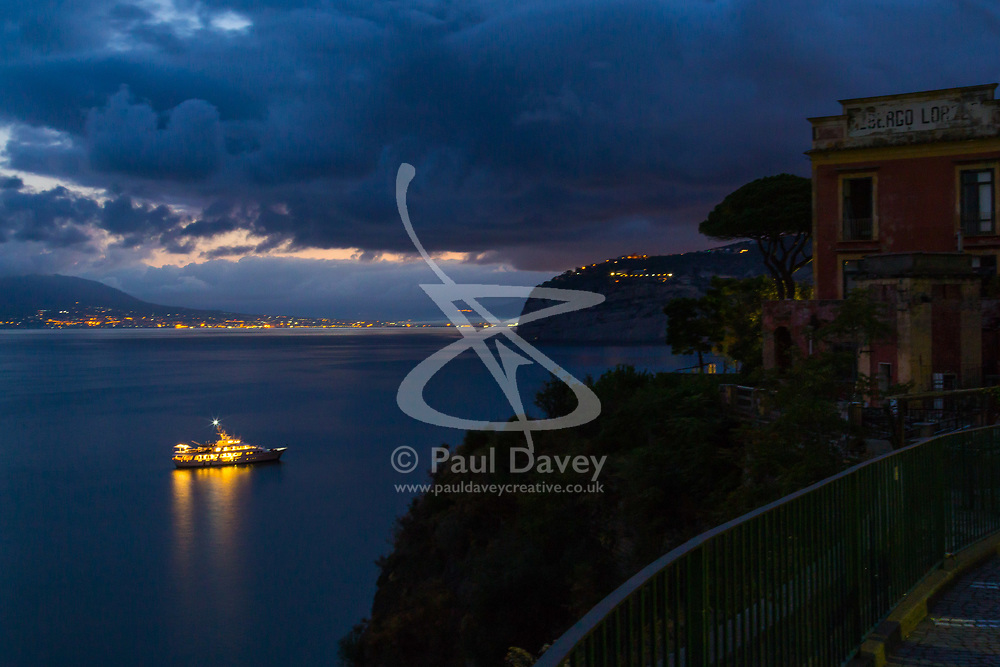Sorrento, Italy, September 15 2017. A motor yacht lies at anchor as day breaks in Sorrento, Italy. © Paul Davey