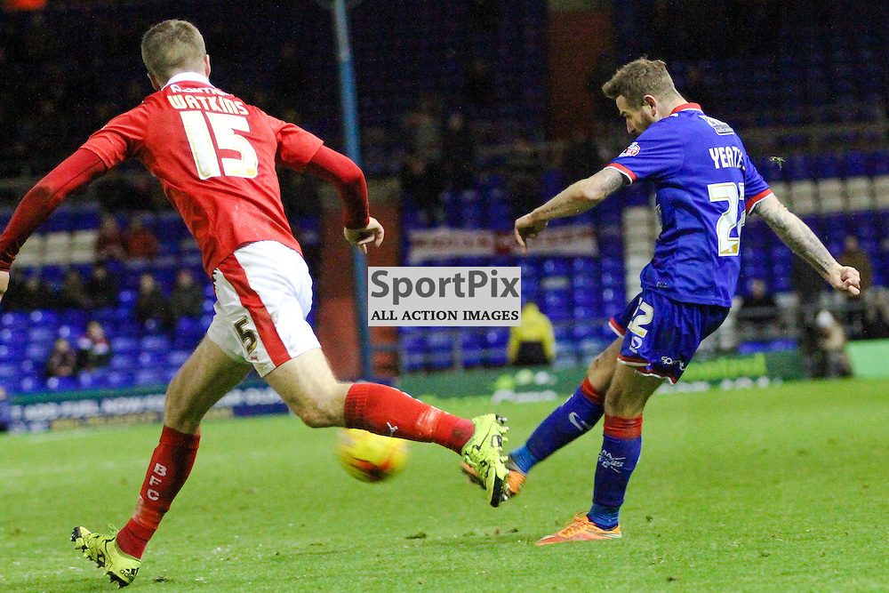 Mark Yeates of Oldham Athletic scoring his goal with Marley Watkins of Barnsley during Oldham v Barnsley, Sky Bet League One, 21 November 2015,  (c) Jackie Meredith/SportPix.org.uk