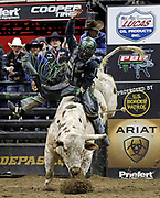Chase Outlaw rides Bottoms Up during the final round of a Professional Bull Riders competition at the Sprint Center, in Kansas City, Mo., Sunday, March 24, 2019. Outlaw won the event, becoming the top-ranked rider in the world. (AP Photo/Colin E. Braley)