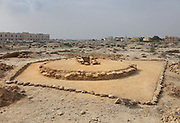 Dilmun tomb, c. 2050 BC, built in dry stone above ground with a cylindrical wall, 1 of 13 middle class, late type mounds, at the Janabiyah Burial Mound Field, part of the Dilmun Burial Mounds site, Janabiyah, Bahrain. The site also includes 5 larger Chieftain Mounds. The Janabiyah tombs were constructed for residents of the villages of Saar and Budaiya. These tombs are at risk, due to the planned construction of a shopping mall. Picture by Manuel Cohen