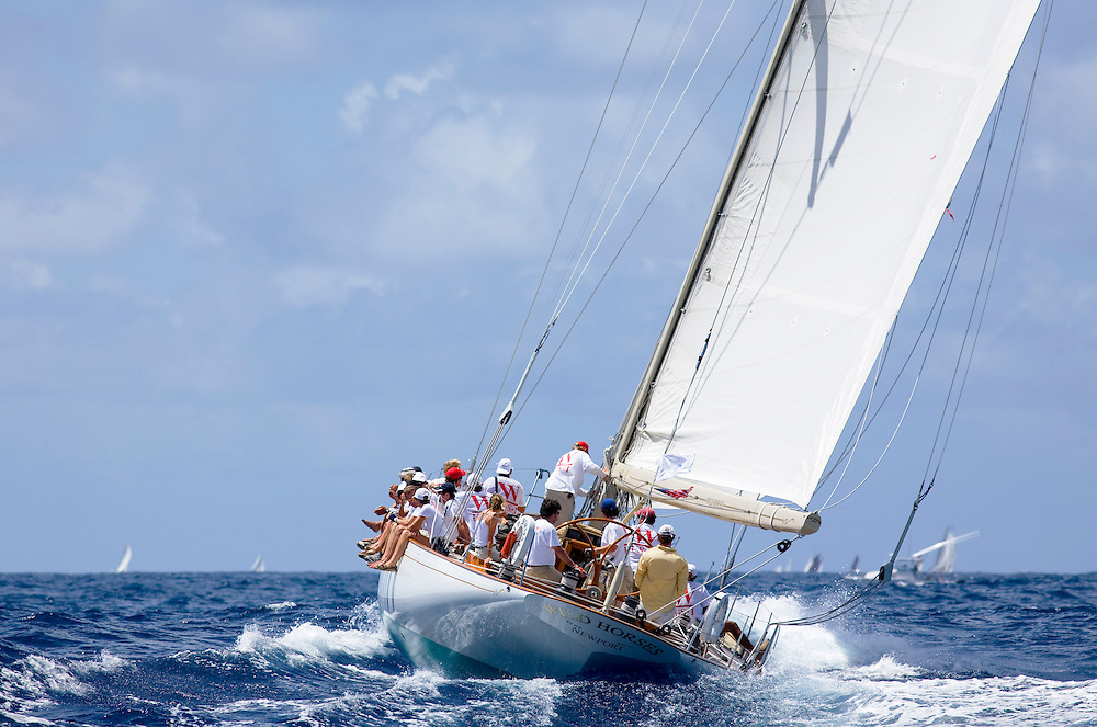 The racing sloop Wild Horses during the 2008 Antigua Classic Yacht Regatta . This race is one of the worlds most prestigious traditional yacht races. It takes place annually off the coast of Antigua in the British West Indies.