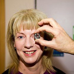 Pictured: Shona Robision tested out a lens that allows optomerists to look at the eye from three different angles<br /> <br /> Health Secretary Shona Robison visited an eye clinic at The Lauriston Building in Edinburgh today to mark the publication of the community eyecare review. She enjoyed a tour of the clinic and meet staff and pateints in for treatment. The review, commissioned last year by the Scottish Government, has looked at how community eye services can be developed and improved. A separate report into hospital eye services will also be published on Wednesday. Ms Robison discussed the report with and Nicola McElvanney, Chair of Optometry Scotland, during her visit.<br /> <br /> Ger Harley | EEm 19 April 2017