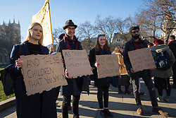 "Westminster, London, January 19th 2016. Students hold an ""emergency protest"" in Parliament Square and later blocking Westminster Bridge, against the cutting of maintenance grants. ""It took just 18 MPs 90 minutes to scrap maintenance grants for the million poorest students, without a debate in Parliament in a backroom committee"" PICTURED: Students display their placards to the press. ///FOR LICENCING CONTACT: paul@pauldaveycreative.co.uk TEL:+44 (0) 7966 016 296 or +44 (0) 20 8969 6875. ©2015 Paul R Davey. All rights reserved."
