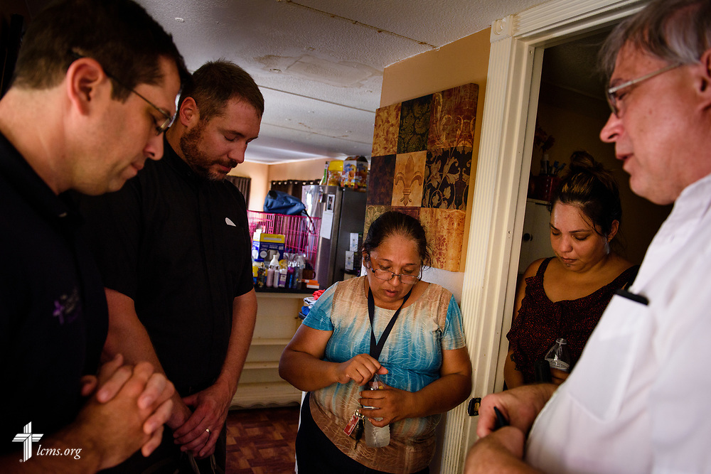 The Rev. Bob Selle of Amigos en Cristo Lutheran Mission (right) leads a prayer with (L-R) the Rev. Dr. Ross Johnson, director of LCMS Disaster Response, the Rev. Michael Meyer, manager of LCMS Disaster Response, Sonia Cerritos and her daughter Evelyn Cardenas, at their hurricane-damaged home on Wednesday, Sept. 13, 2017, in Bonita Springs, Fla. LCMS Communications/Erik M. Lunsford