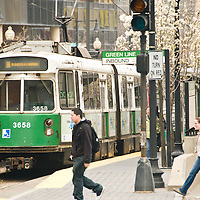 Greenline train in traffic on Huntington Avenue, showing signs of wear. The Green Line runs underground downtown and on the surface in outlying areas. With a daily weekday ridership of 241,100, it is  the most heavily-used light rail line in the country. The line was given the green color because it goes primarily through an area called the Emerald Necklace of Boston