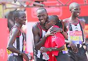Vivian Cheruiyot (KEN) is embraced by pacers after winning the women's race in 2:18:31 in the London Marathon in London, Sunday, April 22, 2018. (Jiro Mochizuki/Image of Sport)