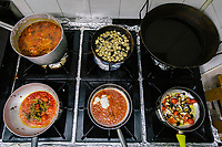 "NAPLES, ITALY - 10 OCTOBER 2018: A view of the kitchen stove at La Taverna a Santa Chiara, a tavern in the historical center of Naples, Italy, on October 10th 2018.<br /> <br /> The idea of the founders Nives Monda and Potito Izzo (two really unusual names in southern Italy) was to create a ""taste gate"" of Campania products. La Taverna a Santa Chiara, founded in 2013, is a modern tavern whose strengths are the choice of regional and seasonal products and mostly small producers. Small restaurant, small producers.<br /> The two partners tried to put producers and consumers in direct contact, skipping the distribution, and managing to reduce the costs of the products considerably. Nives and Potito managed to create a simple kitchen, at moderate costs but with high quality raw materials.<br /> ""A different restaurant idea,"" says Nives, ""the producers deliver their products at low prices and the tavern manages to make traditional dishes with niche products"".<br /> Nives Monda has been a labor consultant for 20 years. Potito Izzo is the chef who has always been loyal to the  family cuisine. When he embraced the idea of Nives he found in the tavern the natural place to express the tradition of Neapolitan cuisine. Nives defines him as a ""comfort food chef"". Their partnership is a true friendship that has lasted for over 10 years."