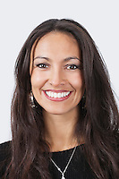 Portrait of smiling young woman over white background