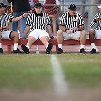 Freferees at a Oxnard High School football game take a break during halftime at Oxnard High School in Oxnard, Calif., on November 9, 2007.