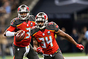 NEW ORLEANS, LA - SEPTEMBER 20:  Jameis Winston #3 of the Tampa Bay Buccaneers rolls out to pass during a game against the New Orleans Saints at Mercedes-Benz Superdome on September 20, 2015 in New Orleans Louisiana.  The Buccaneers defeated the Saints 26-19.  (Photo by Wesley Hitt/Getty Images) *** Local Caption *** Jameis Winston
