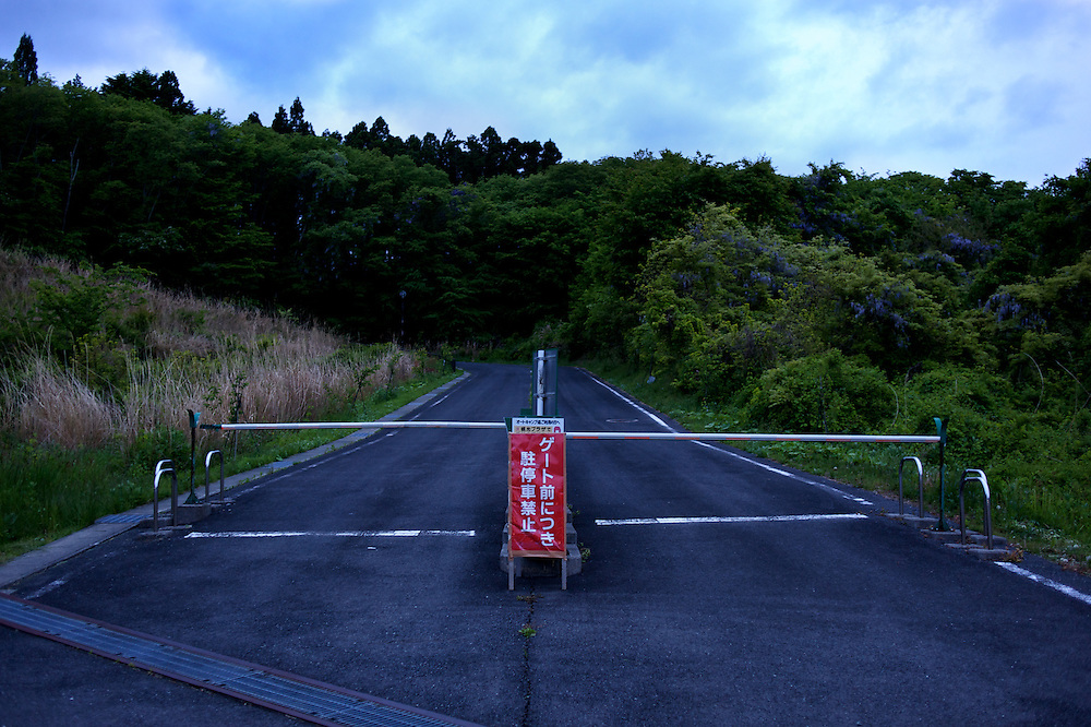 May 28, 2013 - Togura, Japan: A newly build road is seen blocked near hundreds of prefabricated houses used as temporary shelter for families who lost their homes during the devastating earthquake and tsunami that hit the east coast of Japan in 2011. On the third anniversary of the disaster, nearly 270,000 remain displaced. (Paulo Nunes dos Santos)