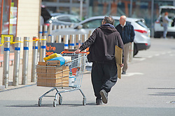 ©Licensed to London News Pictures 30/04/2020  <br /> Dartford, UK. A shopper with a full trolley outside B&Q warehouse store in Dartford, Kent. B&Q have today opened all of its 288 stores in the UK. The DIY retailer has strict social distancing measures in place. Photo credit:Grant Falvey/LNP