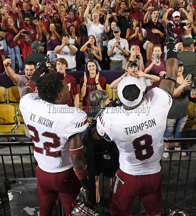 Troy's Kyle Nixon and Emanuel Thompson celebrate with fans after an NCAA college football game against LSU in Baton Rouge, La., Saturday, Sept. 30, 2017. Troy won 24-21. (Photo/Thomas Graning)