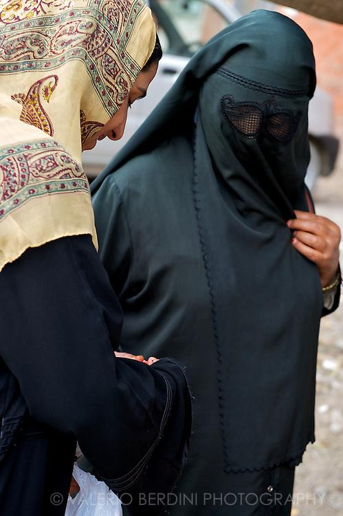 Two women shopping in the bazaar area of Srinagar.