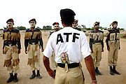 An instructor of the Shaheed Benazir Bhutto Elite Police Training Center, a commando and anti-terrorism academy on the outskirts of Karachi, is instructing recruits. On his t-shirt are printed the letters ATF, meaning Anti-Terrorism force, The training center was founded by retired colonel Abdul Wahid Khan, a brave officer who served as a gunship helicopter pilot in the Pakistani Air Force and around the globe with the United Nations, but who's first task as a young army officer in 1979 was to train Afghan Mujahedeen to fight the Soviet Army, the very Mujahedeen that are today's Taleban.