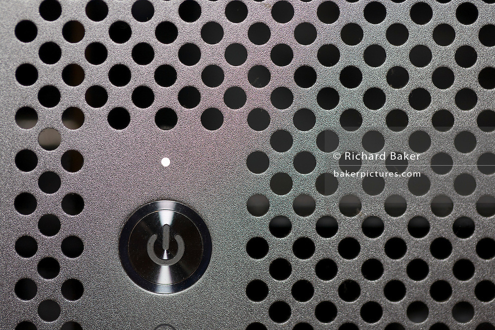 A detail of a first generation (2006) Apple MacPro 4,1 computer on/off power and standby switch. The power symbol is clearly defined on the button, seen universally on all electronic devices and products. The design is also known as IEC 5009.