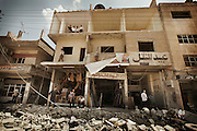 May 10, 2012-Damascus , Syria: People look to the devastation due a massive explosion targeted al-Qazaz crowded intersection at the southern ring-road in Damascus during the morning rush hour on Thursday, killing at least 55 people and wounding 372, the majority are civilians .