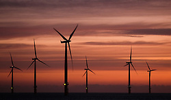© Licensed to London News Pictures. <br /> 07/01/2015. <br /> <br /> South Gare, Teesside<br /> <br /> The first light of morning reaches out over the offshore wind farm at Redcar in Cleveland.<br /> <br /> Photo credit : Ian Forsyth/LNP