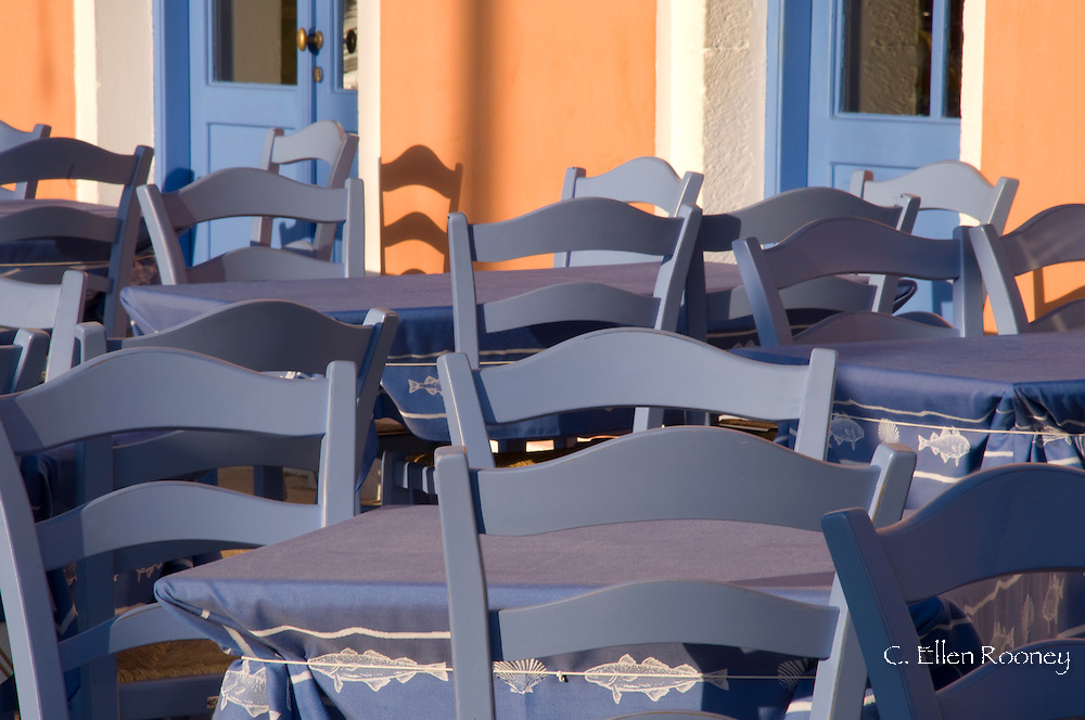 Empty tables and chairs early in the morning in Fiskardo, Kefalonia, The Ionian Islands, Greece