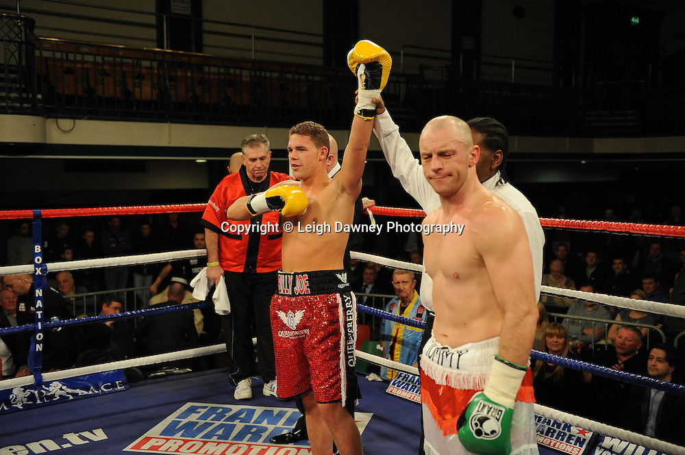 Billy Joe Saunders (red shorts) defeats Tommy Tolan in a 8x3 min rounds Southern Super Middleweight Championship at York Hall, Bethnal Green, London on 14th December 2011. Frank Warren Promotions. Photo credit: © Leigh Dawney 2011.