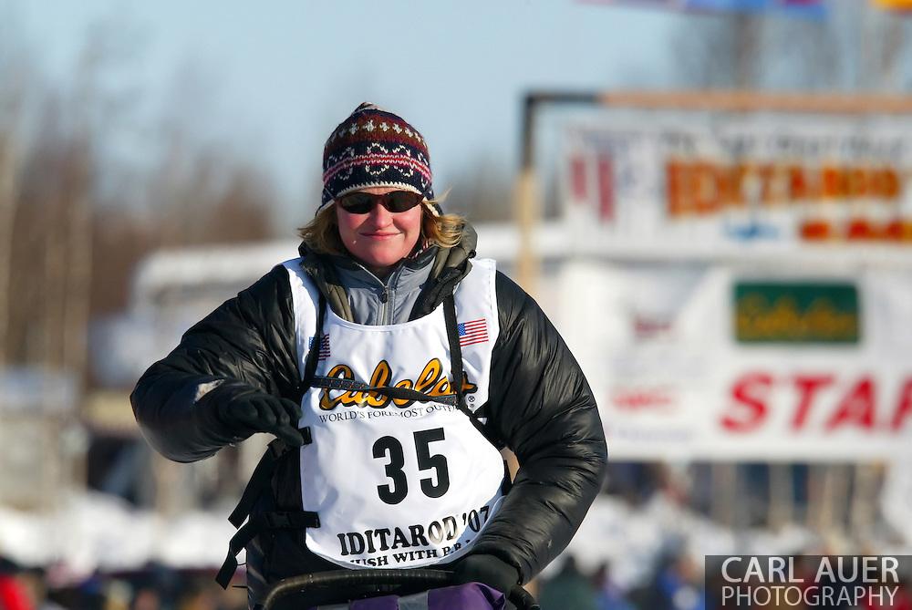 3/4/2007:  Willow, Alaska -  Veteran Melanie Gould of Talkeetna, AK starts the run to Nome in the 35th Iditarod Sled Dog Race