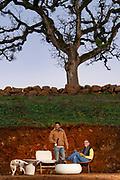 Mark Tarlov & Felipe Ramirez inside the 'living tasting room' with Witness tree in background, Eola-Amity HIlls AVA, Willamette Valley, Oregon