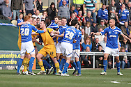 A scuffle breaks out amongst the players after Adam Chapman reacts to a challenge, which leads to Chapman being shown a red card. Skybet football league two match, Newport county v Portsmouth at Rodney Parade in Newport, South Wales on Saturday 29th March 2014.<br /> pic by Mark Hawkins, Andrew Orchard sports photography.