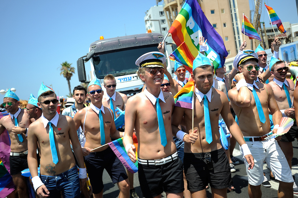Tel Aviv, Israel - June 13, 2014: Russian Members of the gay comminuty take part in the Annual Gay Pride Parade in Tel Aviv on June 13, 2014. More than 100,000 people took part in the Annual Gay Pride Parade in Tel Aviv. Photo by Gili Yaari