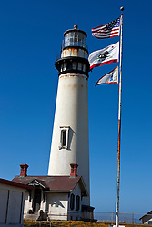 Pigeon Point Lighthouse with American and California flags, Pescadero, California, United States of America