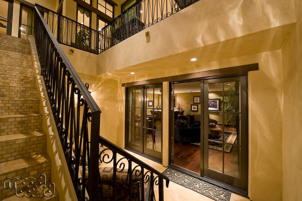 Hallway with staircase in modern home