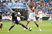 Memphis Depay of Lyon and Adenon Abdou of Amiens during the French championship L1 football match between Olympique Lyonnais and Amiens, on April 14, 2018 at Groupama stadium in Decines Charpieu near Lyon, France - Photo Romain Biard / Isports / ProSportsImages / DPPI