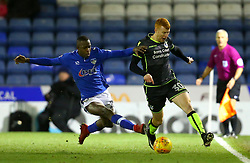 Rory Gaffney of Bristol Rovers goes past Ousmane Fane of Oldham Athletic - Mandatory by-line: Robbie Stephenson/JMP - 30/12/2017 - FOOTBALL - Sportsdirect.com Park - Oldham, England - Oldham Athletic v Bristol Rovers - Sky Bet League One