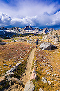 Hiker on the Bishop Pass trail in Dusy Basin, Kings Canyon National Park, California USA