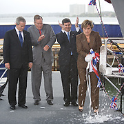 (L-R) U.S. President George W. Bush , former President George H.W. Bush and Northrop-Grumman sector president Michael Petters watch as Doro Bush Koch christens the USS George H.W. Bush at Northrop-Grumman's shipyard Saturday, October 7, 2006, in Newport News, Virginia (VA).  CVN-77 is the 10th and final of the Nimitz-class aircraft carriers.  It is set to replace the USS Kitty Hawk in 2008...Photo by Khue Bui